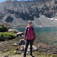 Natasha posing for a photo on a trek through the mountains.