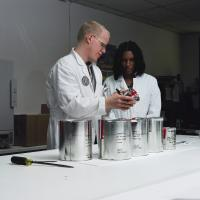 Two ATF forensic chemists review evidence canisters