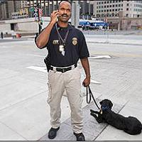 Special Agent Canine Handler George Goodman and K-9 Haiku search for bombs before Major League All-Star Game in Detroit