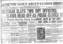 Image of The Daily Argus-Leader newspaper article, dated May 13, 1927, titled Chrisman Slays Two Dry Officers; Blows Head of as Posse Closes In