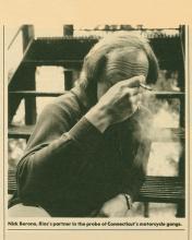 Image of Special Agent Rios partner Nick Berone smoking a cigarrette.