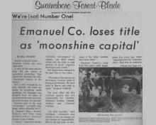 Artículo de noticias de Swainsboro Forest-Blade con titular: ¡No somos el número uno! El Condado de Emanuel pierde el título como Moonshine Capital
