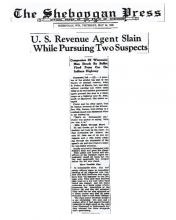 Newspaper article from The Sheboggan Press, with headline: U.S. Revenue Agent Slain While Pursuing Two Suspects