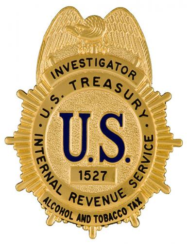 Image of the badge for the Alcohol and Tobacco Tax Division, Internal Revenue Service, U.S. Department of the Treasury 1952-1967