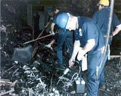 Picture of ATF agents sifting through the rubble of the Dupont Plaza Hotel.