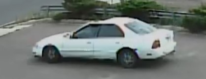 Image of driver's side of white getaway vehicle