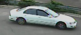 Image of passenger's side of white getaway vehicle