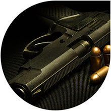 Image of a handgun and bullets
