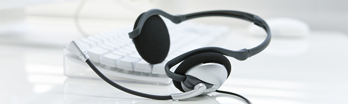 Picture of a headset resting on a keyboard.