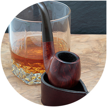 Image of a tobacco pipe and a glass of liquid