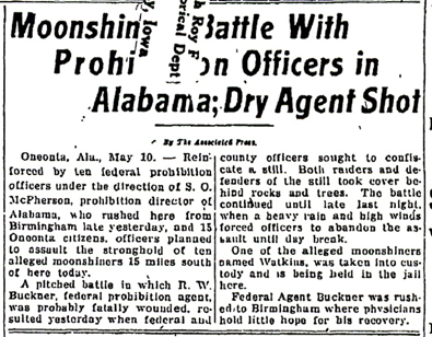 Image of a newspaper article with headline - Moonshine Battle With Prohibition Officers in Alabama; Dry Agent Shot