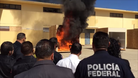 Image of the Mexican Federal police watching a test burn