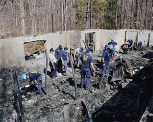 Historical Image of an ATF National Response Team investigating an arson scene.