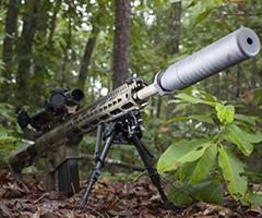 Imagen de un arma con supresor