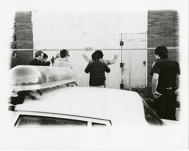 Image of special agents arresting a suspect