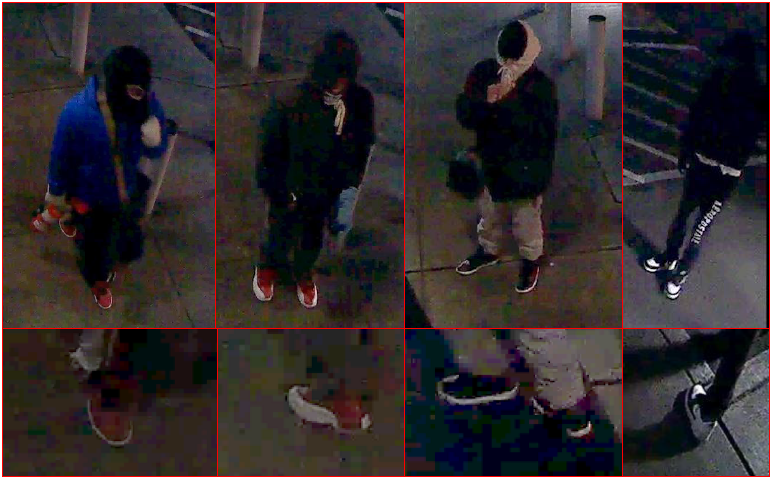 Image of the suspects with their faces covered, wearing blue and black coats and a black ski mask.