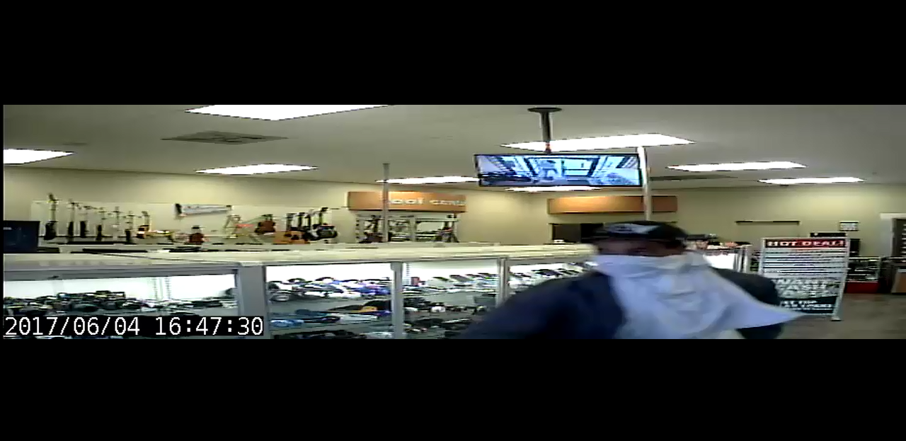 Security footage of suspect 2 during the EZ Pawn Robbery