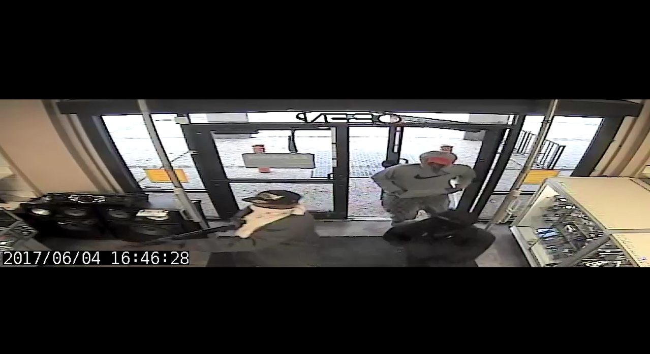 Security footage of three suspects entering EZ Pawn.