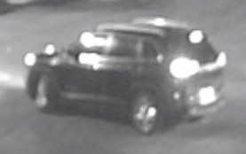 Rear view of the dark SUV seen leaving the scene of the crime