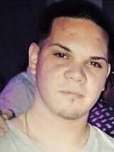 Headshot of Christian Roman who is wanted for possession of stolen firearms