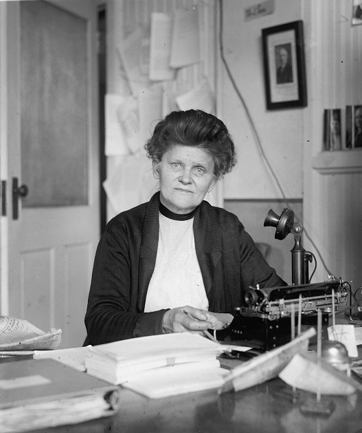 Prohibition Agent Georgia Hopley sits at her desk in Washington, D.C.