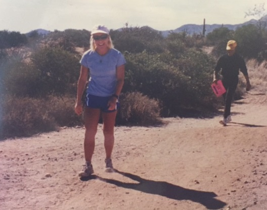 An image of Nicole Strong walks on desert trail