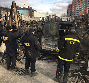 Image of ATF certified fire investigators on a fire scene.