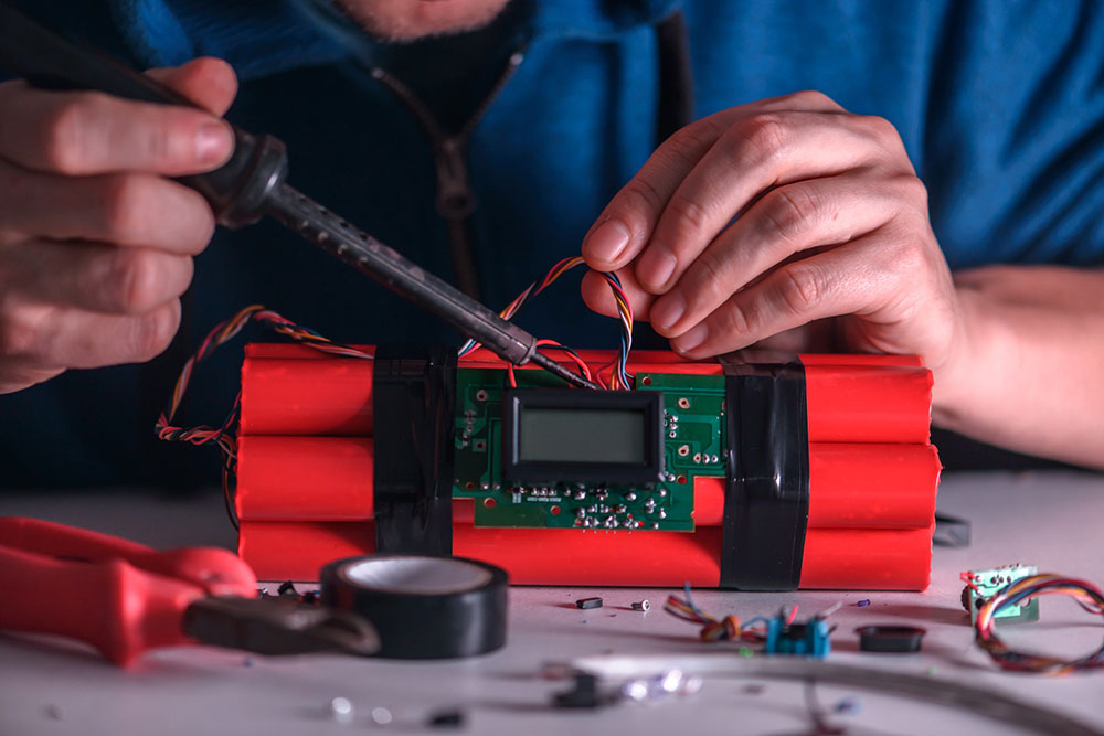 Image of an expert dismanteling a bomb