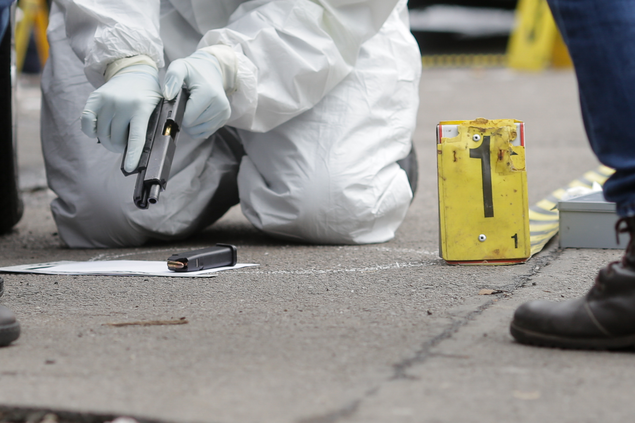 Image of a firearm being recovered form a crime scene