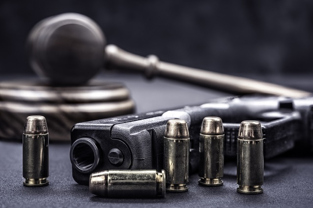 image_of_gun_bullets_and_gavel