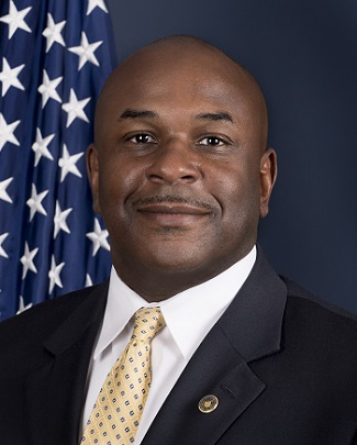 Image of a headshot of Special Agent in Charge Marcus Watson in front of the American flag.