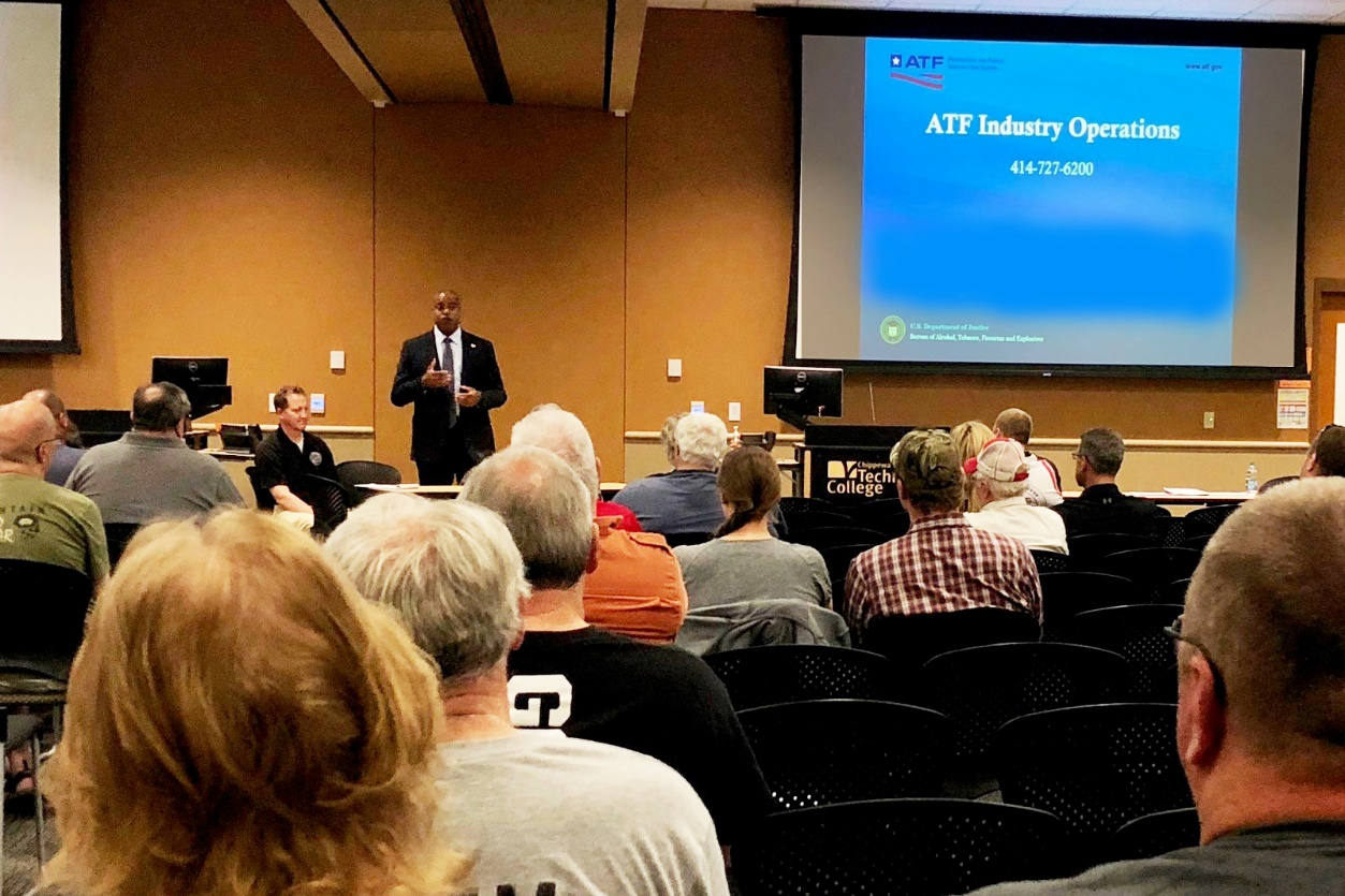 Assistant Special Agent in Charge Joel Lee, of the ATF St. Paul Field Division, welcomes federal firearms licensees to the ATF federal firearm licensee educational seminar held at the Chippewa Valley Technical College