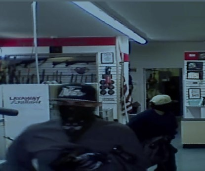 Image of masked suspects inside of American Jewelry and Pawn Robbery