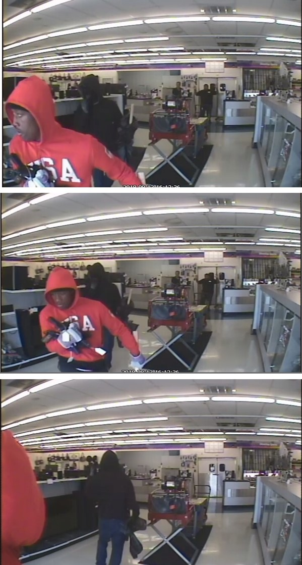 Image of two suspects robbing the American Pawn shop.