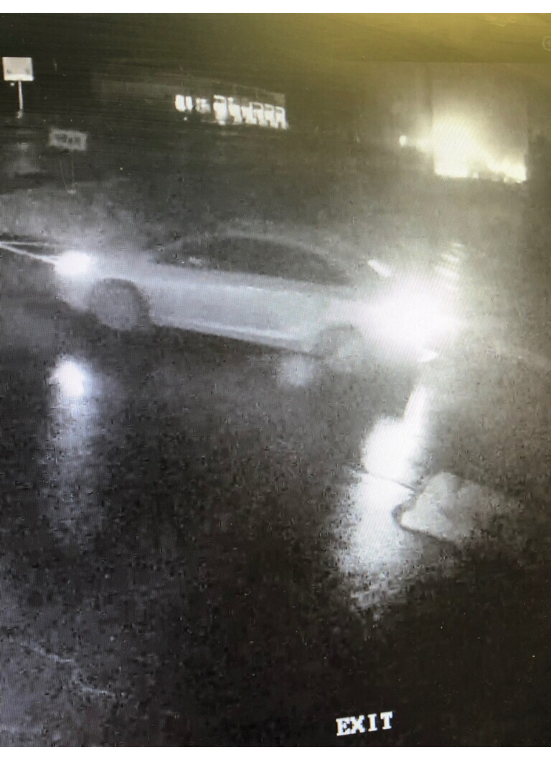 Image of a small light colored sedan used during the crime.