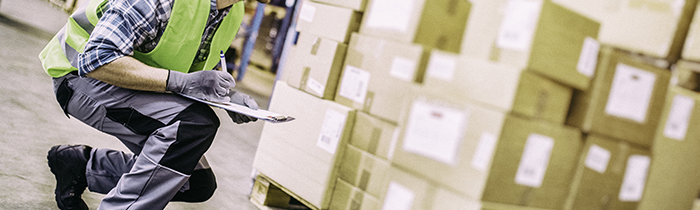 Image of a warehouse staffer instecpting the stock