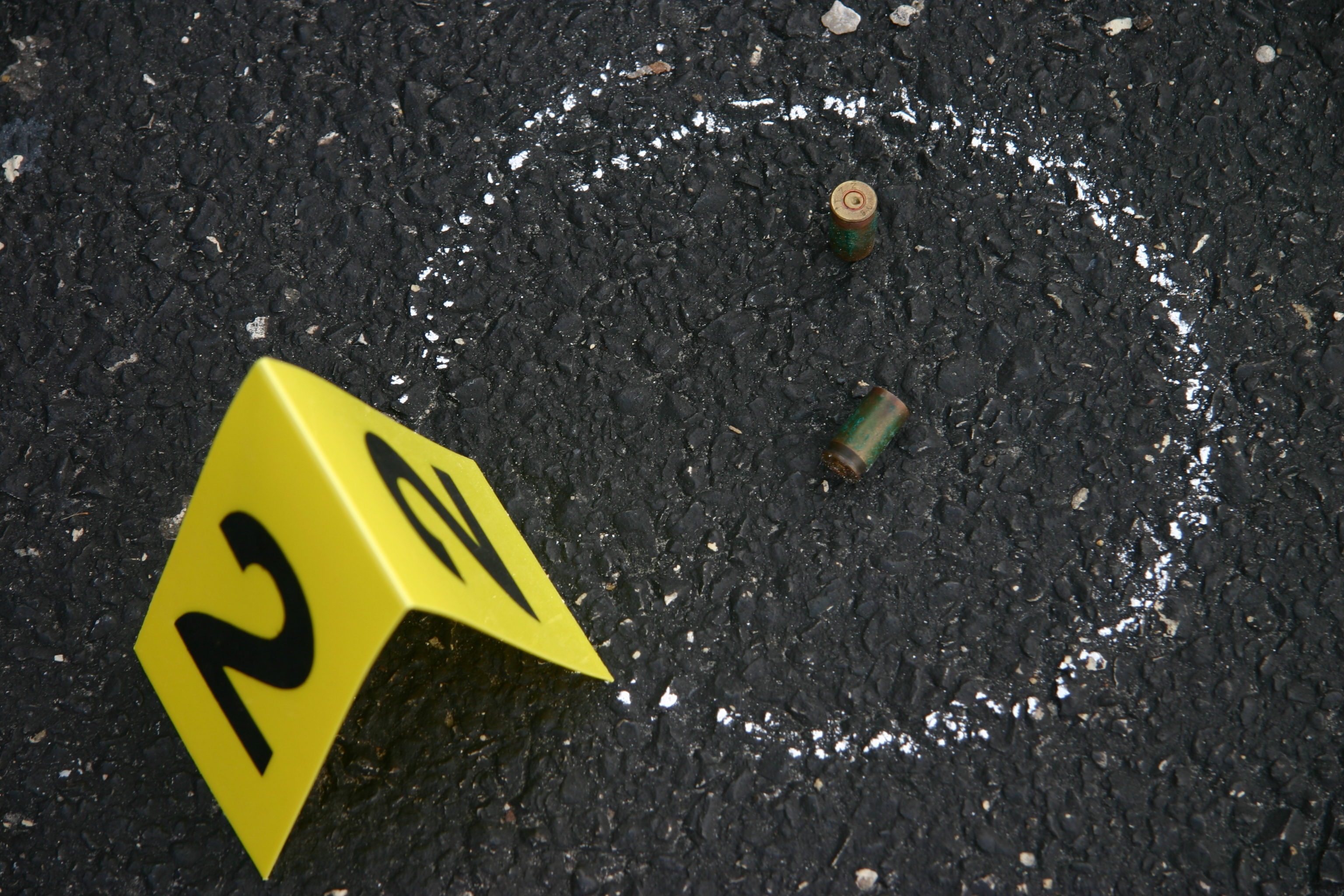 Image of a bullet in chalk outline