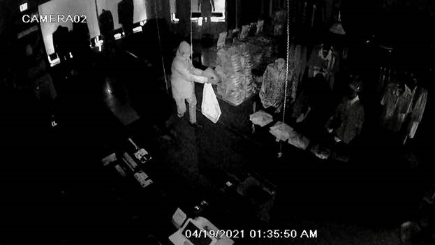 An arson suspect inside the Top 2 Bottom Fashion store in Brooklyn Park, MN