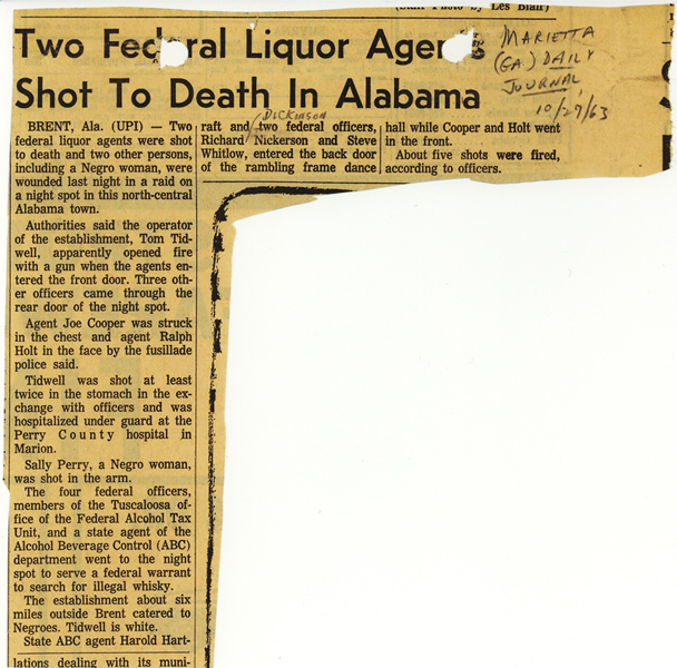 Newspaper article with headline, Two Federal Liquor Agents Shot to Death in Alabama