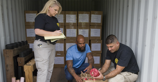 Industry operations investigators conduct a fireworks inspection