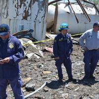 NRT members survey wreckage from a fire in West Texas