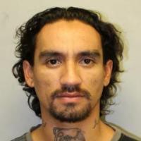 Image of wanted felon Justin Joshua Waiki